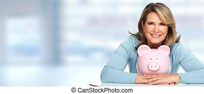 Senior woman with a piggy bank. - Senior woman with a piggy...