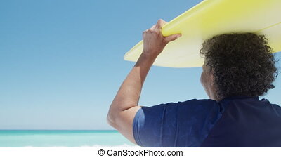 Senior woman with a surfboard