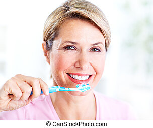 Senior woman with a toothbrush.
