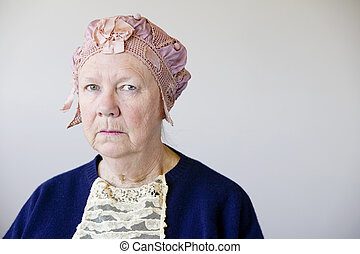 Senior woman with a vintage hat