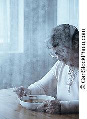 Senior woman with appetite problem