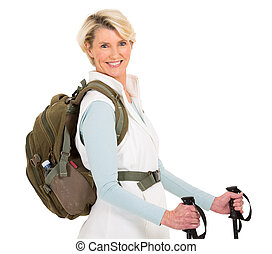 senior woman with backpack and hiking poles