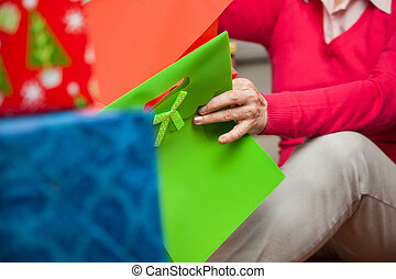 Senior Woman With Bags Sitting On Floor
