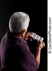 Senior woman with blister medications
