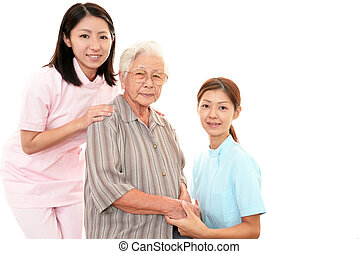 Senior woman with caregivers
