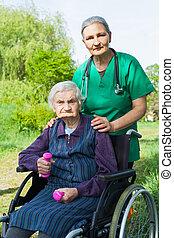 Senior woman with caregvier
