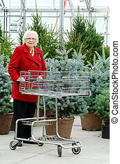 Senior woman with cart shopping