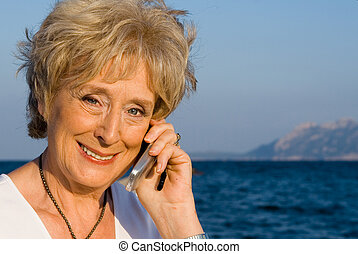 senior woman with cell or mobile phone