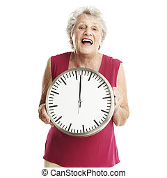 senior woman with clock