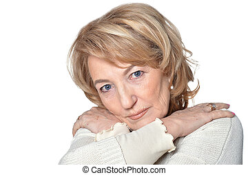 Senior woman with crossed arms