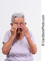 senior woman with eyes on white background