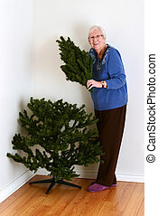 senior woman with fake tree