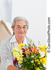 Senior woman with flowers