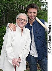 Senior woman with gardener