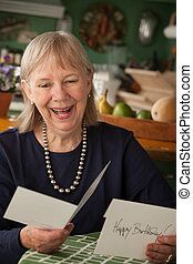 Senior woman with greeting card