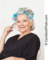 Senior Woman With Hair Curlers