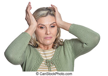 Senior woman with headache on white background