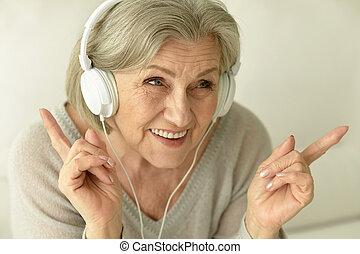 Senior woman with headphones
