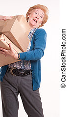 Senior woman with heavy parcels