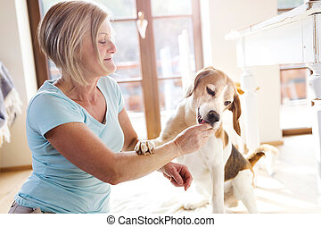 Senior woman with her dog - Senior woman with dog inside of...