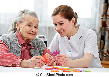 Senior woman with her elder care nurse - Elder care nurse...