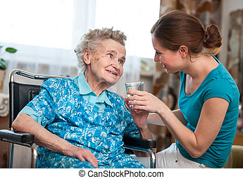 senior woman with home caregiver - Senior woman with her ...