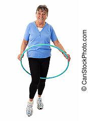 Senior woman with hula-hoop