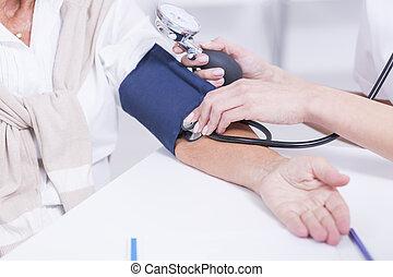 Senior woman with hypertension