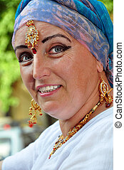 senior woman with Indian jewlery in the street