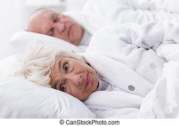 Senior woman with insomnia
