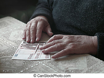 Senior woman with little euro money, toned image, colorized,...