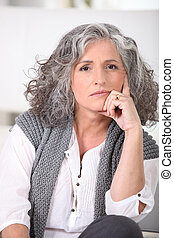 Senior woman with long grey hair