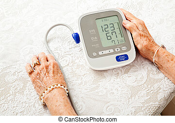 Senior Woman With Low Blood Pressure - Closeup of a senior ...