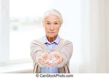 senior woman with medicine at home