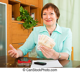 Senior woman with money