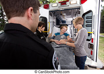 Senior Woman with Paramedics - Senior woman being...