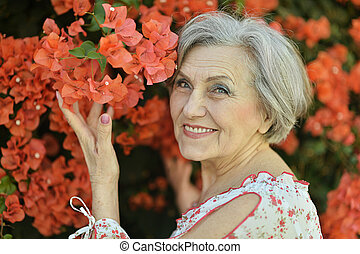 woman with red flowers