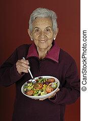 senor woman with salad