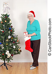 Senior woman with santa hat