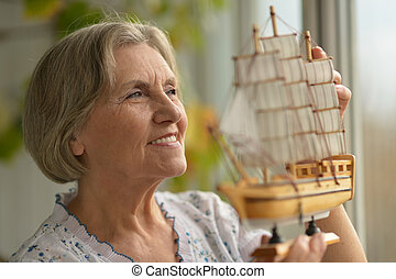 Senior woman with ship
