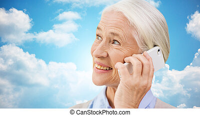 senior woman with smartphone calling