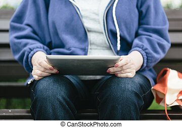 Senior woman with tablet pc