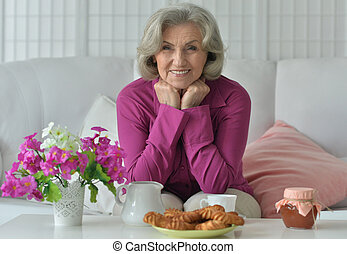 Senior woman with  tea at home