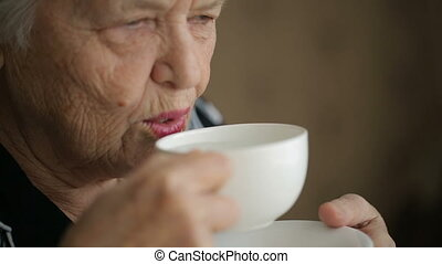 Senior woman with tee cup