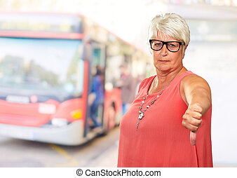 Senior Woman With Thumbs Down, Outdoor