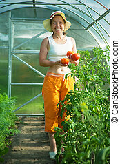 Senior woman with tomato