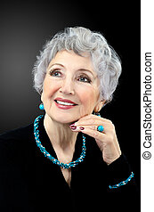 Senior woman with turquoise set