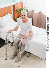 senior woman with walker in hospital