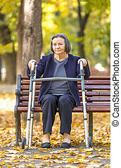 Senior woman with walker outdoors