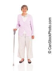 senior woman with walking cane